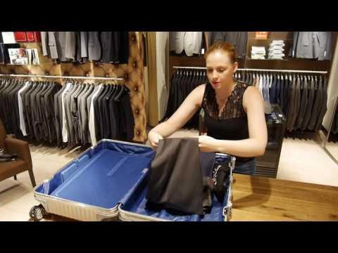 Wie packe ich die Anzüge richtig in meinen Koffer.