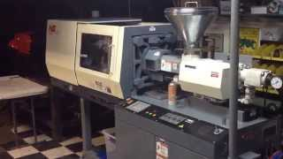 Nissei NS40 5A injection molding machine.