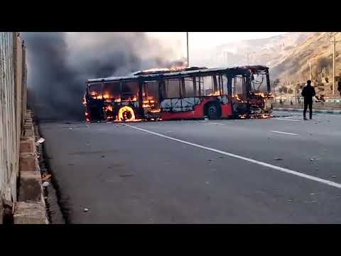 Protesters in Tabriz torch a bus after Iran gas price  hike