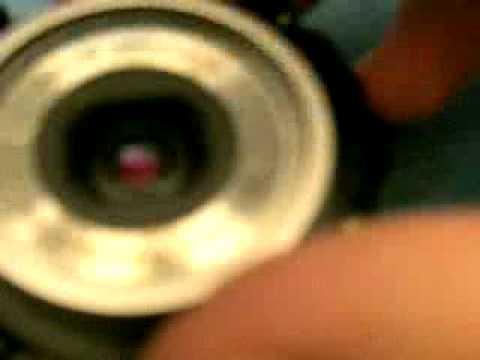 Sacando la lente de una camara de fotos digital Casio
