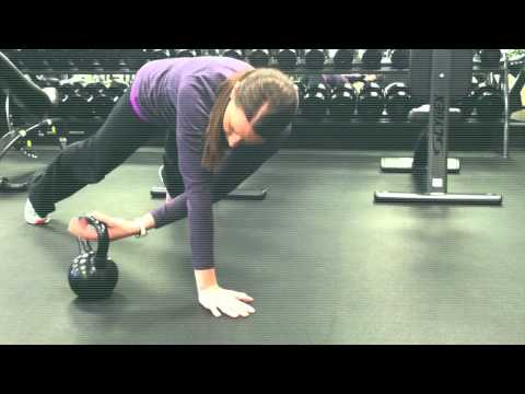 Plank With Kettlebell Pass