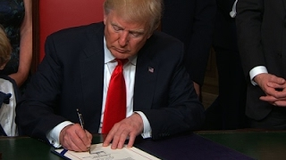 Raw: President Trump Signs First Law