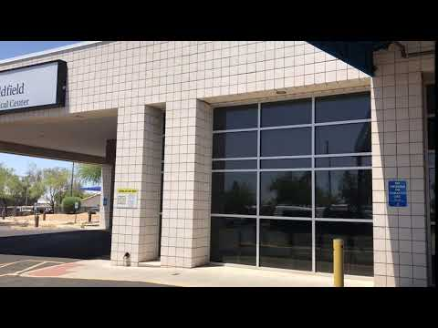 Pan Left From Arizona Banner Goldfield Sign To Emergency Room Entrance - Free Stock Footage