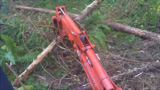 Trail Building Grading and Leveling, Using the Backhoe Thumb With the Kubota BX25