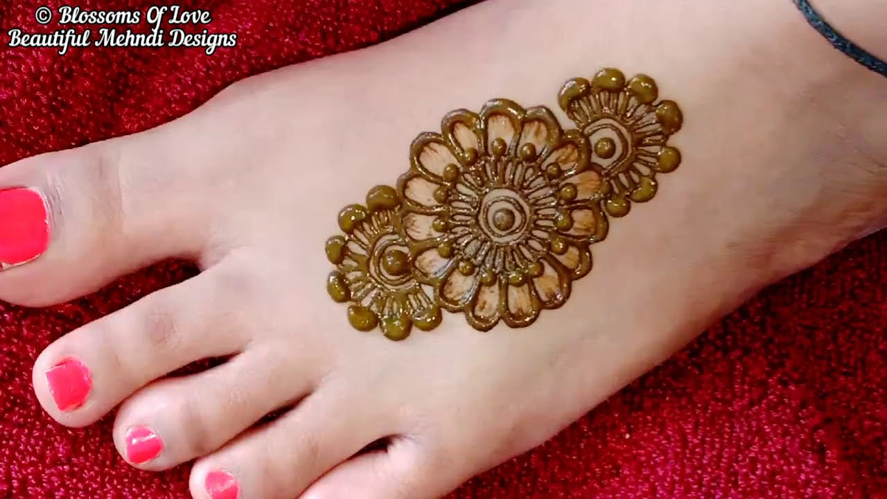 shaded leg mehndi design floral by blossoms of love