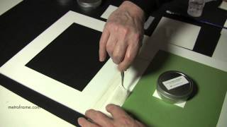 Attaching artwork with a T-Hinge to backing board