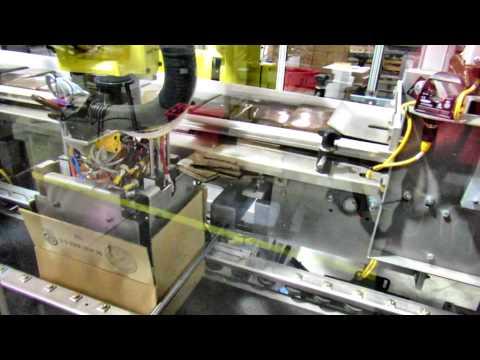 Empaque de Cajas con Robot y Paletizado