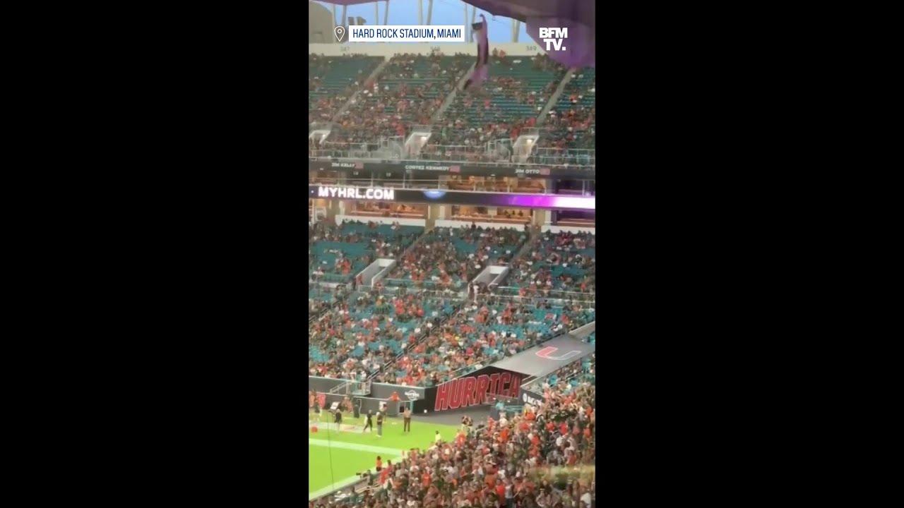 Ce chat suspendu au Hard Rock Stadium de Miami a été rattrapé dans sa chute par des supporters