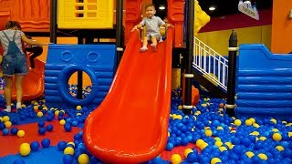 Kids indoor playground / Vlad have fun with toys, slides and trampolines in play area for children