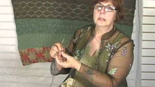 Knitting Instructional Video: How to Attach a Pom Pom to a Knitted Piece