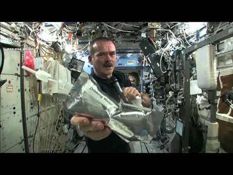 Wringing out water from a towel aboard the ISS