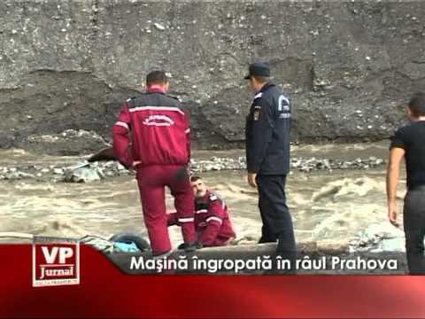 Maşină îngropată în râul Prahova