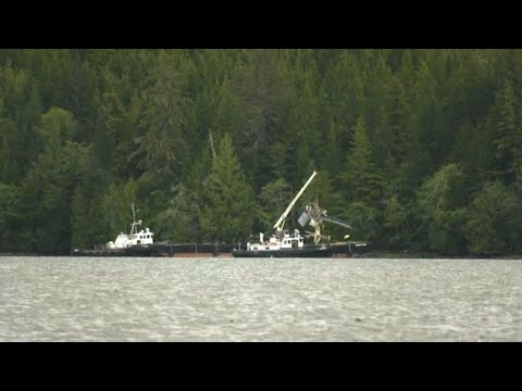 Responders in Ketchikan, Alaska recovered the wreckage of the larger of the two planes that collided this week, according to federal accident investigators. It was lifted onto a barge. Officials say recovering the smaller plane will take longer. (May 16)