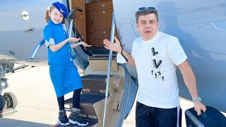 Nastya pretends to be a flight attendant for dad on the plane