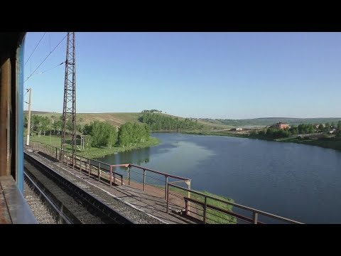 Train ride in Russia. View back from the train window. Life in Siberia