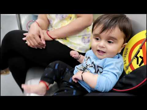 Very cute 10 month baby playing Delhi metro new baby in blue motion face behaviour expression happy