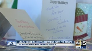 Mom sending Christmas cards to troops