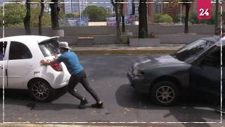 Petrol shortages trigger long queues in Caracas during pandemic