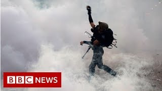 China warns Hong Kong protesters not to 'play with fire' - BBC News