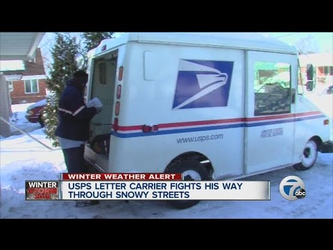 USPS letter carrier fights his way through snowy streets