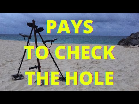 Beach Metal Detecting, Pays To Check The Hole