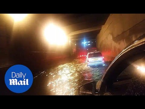 Uber driver forced to make journey through flooded tunnel - Daily Mail