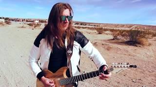Playing Guitar in Arizona Desert (theme of the rebels)