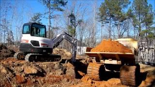 Mini Excavator Loading A Track Truck