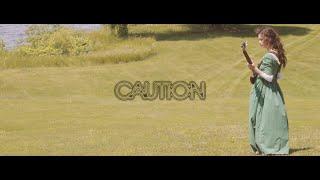 "Caution – ""Act Rich"""