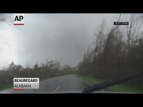 A storm chaser captured the moment a tornado hit Beauregard in Alabama killing at least 23 and injuring more than 90 people. (March 5)