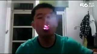 Crazy Chinese Guy! Magic trick smoking and eating cigarettes