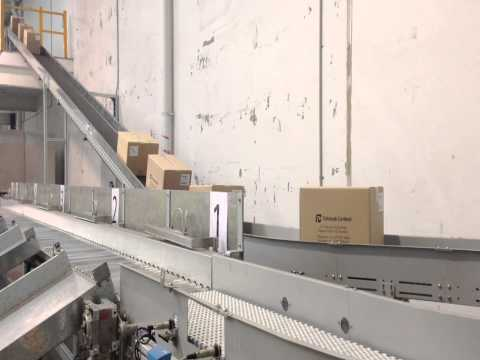 Modular belt conveyor as part of turnkey conveying system in a cardboard packaging factory