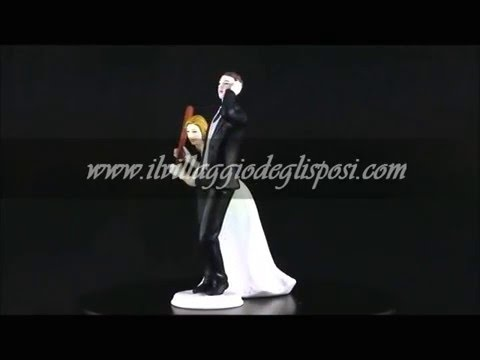 Video - Sposa con la mazza e sposo al cellulare
