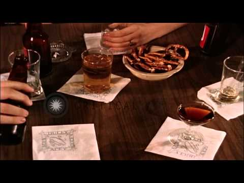 Men and women drinking alcohol at a bar in United States. HD Stock Footage