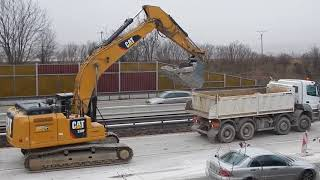CAT 330F loading MERCEDES and Scania