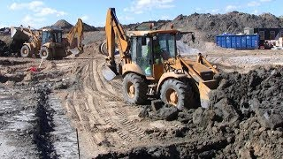 2x Hydrema 906D Backhoe Moving Clay Teamwork