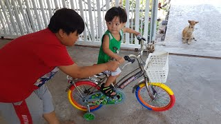 Baby has a new bike - Baby learns to ride a bike