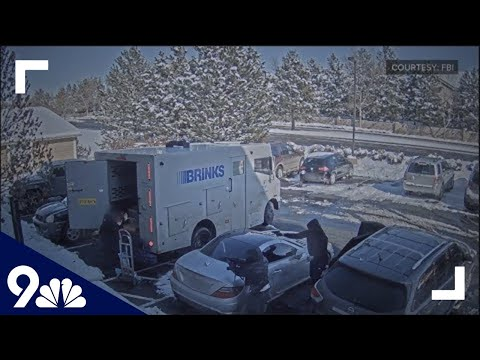 Suspects caught on video robbing armored vehicle