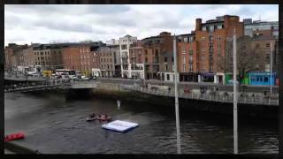 Man flies over the ha'penny bridge in a Jet Pack