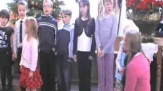 Away in a Manger children sing the Christmas carol