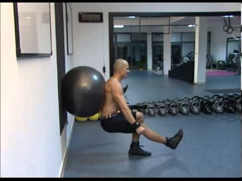 One Legged Squat Exercise: One Legged Wall Squat with a Swiss ball