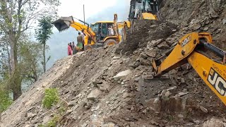 JCB Eco Xcellence Backhoe-in Hilly Road-Leveling Uniquely