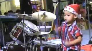 Joan Jett song, little boy playing the drums