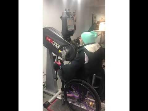 Kylie uses her hand-bike to train