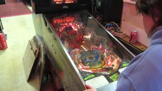 Jenn Van Noy playing Scared Stuff pinball machine at fantasy raceways