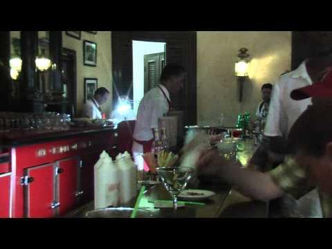 Ernest Hemingway stands in El Floridita (Havana, Cuba) at the bar