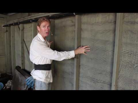 Can I waterproof outside stucco walls from the inside of my home