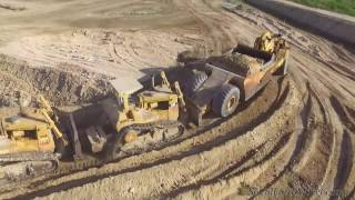 CAT D10N pushcat's loading 660B scrapers (full coverage…)