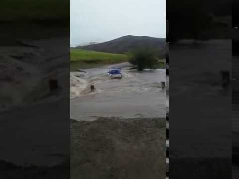 Flooding river fails to wash away this bakkie
