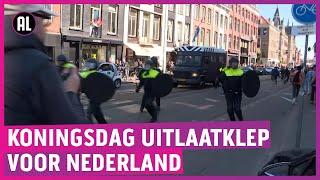 Politie grijpt in op Koningsdag in 020; feestgangers vluchten